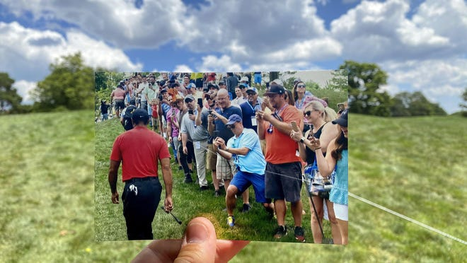 A photo of spectators watching Tiger Woods on the way up the hill to the third hole from the 2019 Memorial Tournament is held in the same spot it was taken one year later at the 2020 tournament, which played without spectators due to COVID-19.