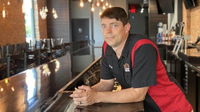 Brett Cotton, owner of Cotton Brewing Co., Copper House Coffee and Rice & Barley Taphouse in Adrian, stands inside Rice & Barley on Tuesday, which he has not been able to reopen due to COVID-19 restrictions. Cotton testified before a Michigan House Ways and Means Committee July 17 in support of social district legislation.