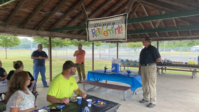From left, Morenci Mayor Sean Seger, city administrator Mike Sessions speak during the retirement party of Morenci Police Chief Mike Creswell at Wakefield Park, Thursday, July 16.