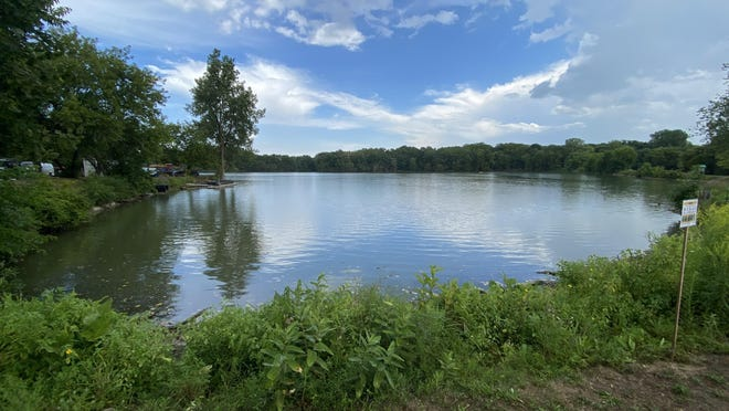 Glove Mill Pond in Tecumseh is pictured Friday. The Lenawee County Health Department is advising people and their pets to avoid contact with the poind's water due to the presence of potentially harmful blue-green algae.