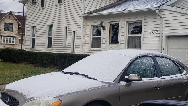 A slight dusting of snow covers the windshield and hood of this vehicle, pictured Tuesday morning in Hudson. Lenawee County, mainly the western portion, recorded its first snowfall of the 2020 fall/winter season Tuesday morning. No significant snowfall accumulated.