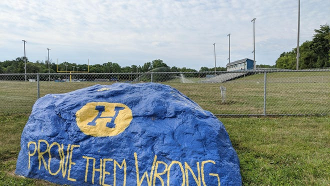 A painted rock at Hillsdale High School offers words of inspiration to students and graduates. Sam Fry/Daily News