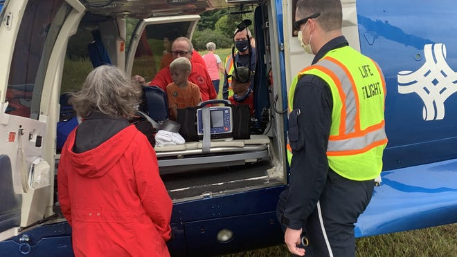 A Life-Flight crew out of St. Vincent's Mercy Hospital in Toledo, Ohio showcases a helicopter used to airlift patients to higher levels of care in emergencies.