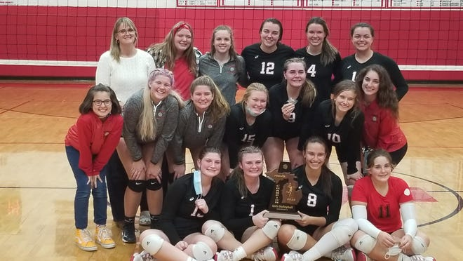 Camden-Frontier's varsity volleyball team poses with the district trophy after defeating Hillsdale Academy in five sets in Friday's district final. Courtesy Photo/Dave Follis