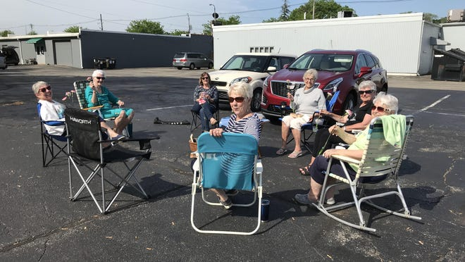 Long time friends, the Water Lilys, met in the parking lot of Southside Inn to catch up on Thursday, June 4, 2020. From left to right going clockwise, Pat Flynn, Norma Westhuis, Linda Van Appledorn, Linda Bremer, Wanda Hassevort, Connie Petroelje and Gretchen Wiegerink.