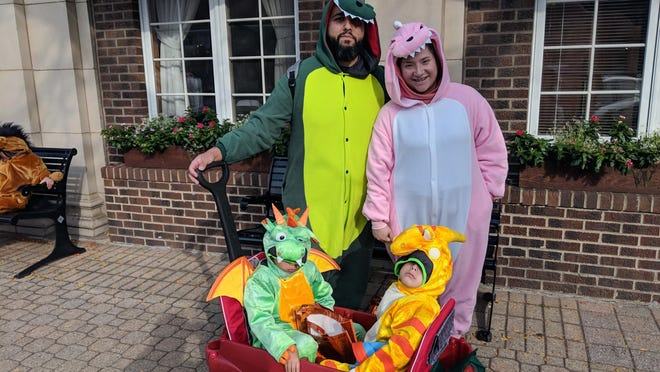 A family poses for a photo during downtown Holland's trick-or-treating event in 2018. The event has been canceled this year due to COVID-19.