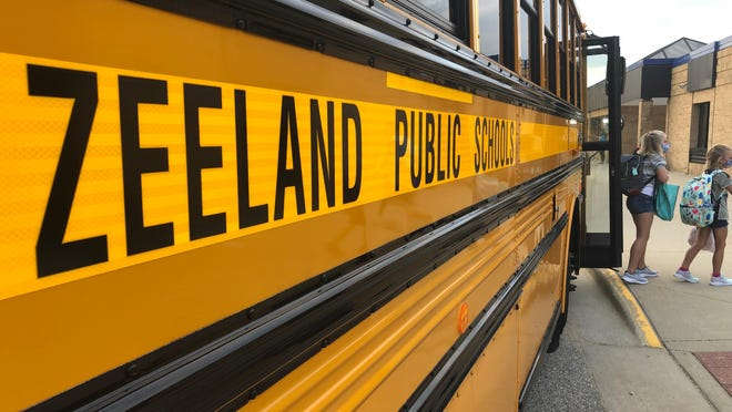 Students step off a school bus for their first day back to class Tuesday, Sept. 1, at New Groningen Elementary.