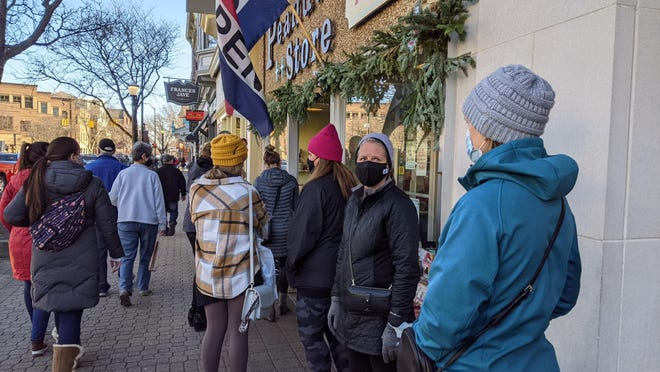 Downtown Holland saw hundreds of visitors on Small Business Saturday despite the pandemic, with lines forming regularly outside The Peanut Store and other Eighth Street businesses.