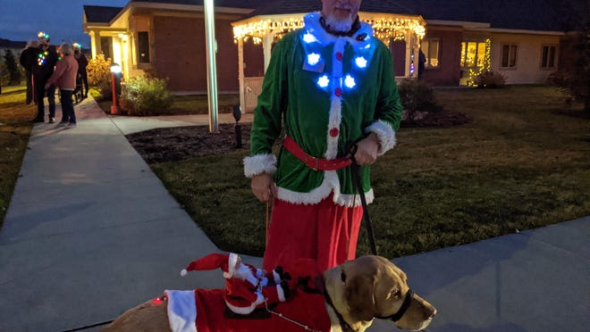 Several participants in the Parade of Lights Walk at Appledorn Assisted Living Center in Holland brought their dogs with them, some adorned with lights and decorations of their own.
