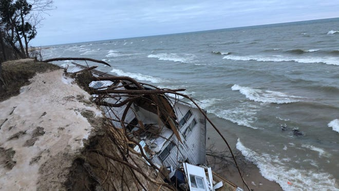 Patricia Gancer's cottage, located in White River Township along Lake Michigan, fell over the edge of a sand bluff due to erosion on Dec. 31, 2019.