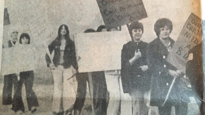 At 7 a.m. Sept. 7, 1974, mothers from the Bacon St. area marched in front of Earl E. Matthews Jr.'s home on Ruff Dr. carrying signs demanding a bus for their children who attend South Monroe Townsite Elementary School. Matthews was president of the Monroe Public Schools' Board of Education.