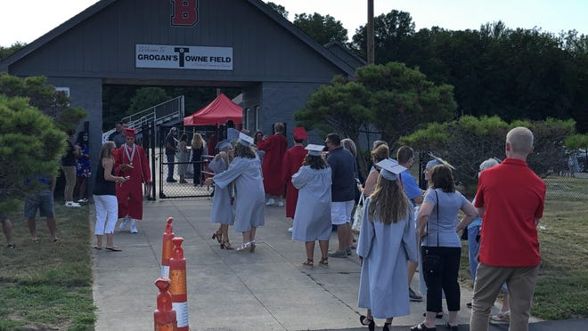 Bedford High School's newest graduates wait to enter the football stadium Tuesday for the second of two graduation ceremonies held for the Class of 2020.
