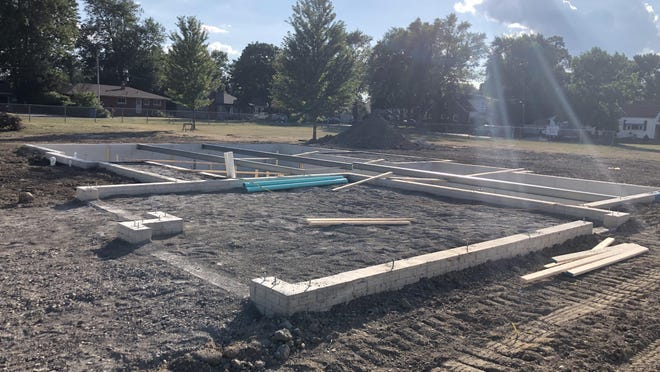 The ground has been dug and concrete poured to begin construction of Trojan Build 3 in the 15000 block of Charles St., located at the site of the former South Monroe Townsite Elementary School.