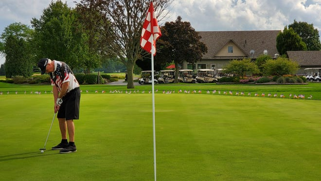 Club member Dick Tangeman putts during the Folds of Honor/Patriot Golf Day at Green Meadows Golf Club Monday.