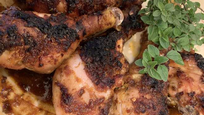 Jerk chicken is a popular dish served during Karamu, the final day of Kwanzaa. It's made with a spice blend including allspice, thyme, black pepper and other flavors.