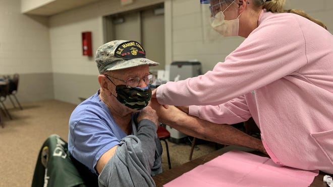 District Health Department Four Public Health Nurse Christine Gouine, RN, gave the COVID-19 vaccine to Maurice Van Gordon, a 98 year old WWll Veteran from Cheboygan, at the clinic at the Knights of Columbus Hall in Cheboygan. Contributed photo