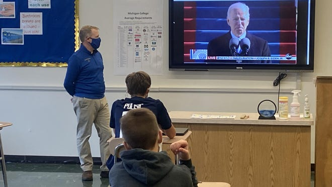 Ida Middle School teacher Jeremy Potter watches the inauguration address of President Joseph Biden Jr. along with students in his seventh grade social studies class Wednesday afternoon.