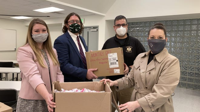 The Allegan-Van Buren Office of the Public Defender delivers boxes of tampons to the Allegan County Jail on Friday, Jan. 29, 2021. From left, Frankie Badur, social worker, Chad Catalino, director of the Office of the Public Defender, Lt. Jim Miller, jail commander, and Jessica Winsemius, deputy chief public defender.