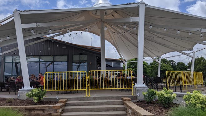 Diners enjoy the updated patio at Boatwerks in downtown Holland. The Ottawa County Department of Public Health is working closely with restaurants to ensure compliance throughout the pandemic, as well as lightening the load for restaurant owners coping with ongoing changes in regulation.