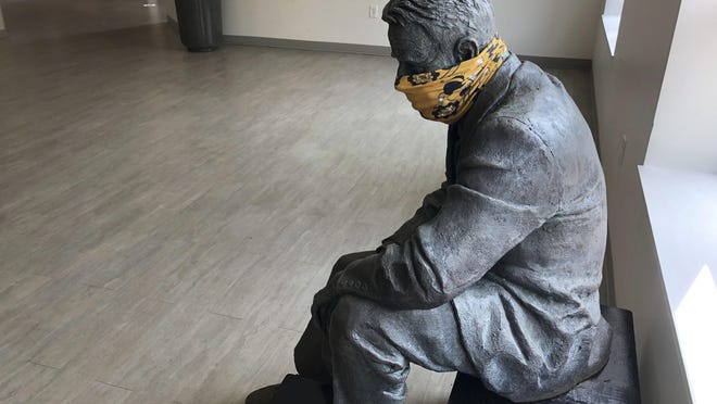 A statue is masked inside a building on the first day of classes Aug. 17, 2020, at Georgia Tech in Atlanta.