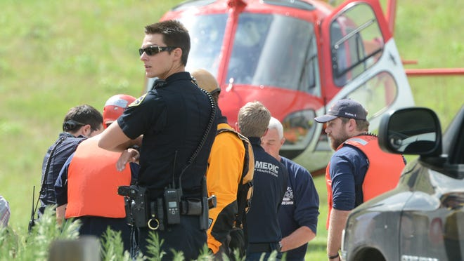 Officials wheel a 25-year-old female to the Air Link helicopter at the Hewlett Gulch Trailhead Wednesday afternoon June 4, 2014, where authorities responded to a river rafter who fell in the river while on a rafting trip on the Poudre River.