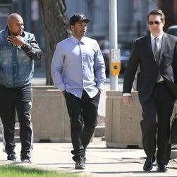 Mendeecees Harris, center, walks into federal court in Rochester, N.Y., with his attorney Donald Thompson, right, and a companion in 2014. Harris was sentenced to eight years in prison in a federal drug trafficking case.