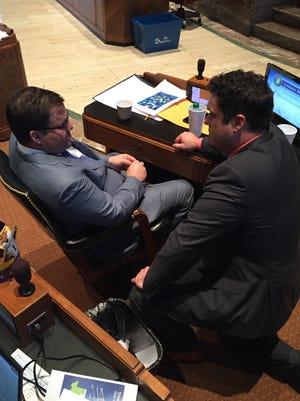 Acadiana Reps. Stuart Bishop, R-Lafayette, and Blake Miguez, R-Erath, discuss the budget on the House floor Wednesday.