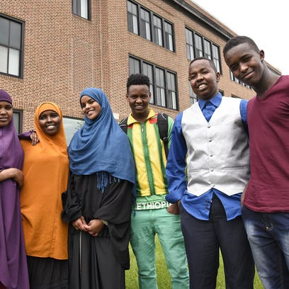 McKinley School President Al Johnson speaks during a group meeting of Somali students May 28 at Tech High School.