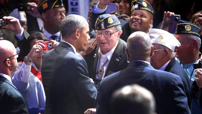 President Barack Obama greets a veteran after speaking about veterans issues. Vets are calling on the President to visit the trouble Phoenix VA during his visit this week.