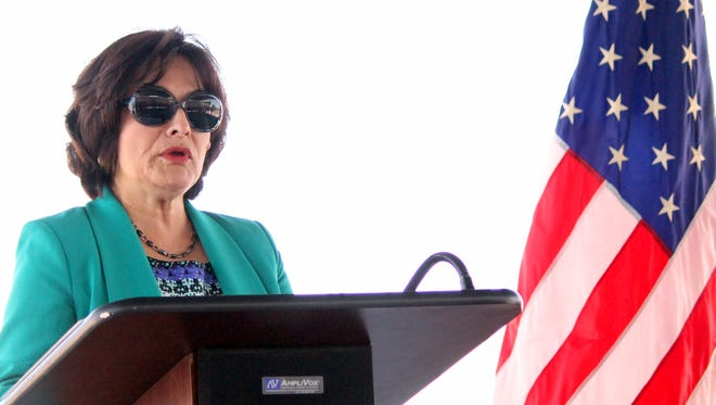 Sylvia Hernandez stands at the podium Wednesday during a press conference at the U.S. Port of Entry near Columbus, N.M. Hernandez is the regional director for the GSA and a Deming High graduate. She is the daughter of Mr. and Mrs. Richard Leyba of Deming.