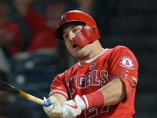July 25, 2019; Anaheim, CA, USA; Los Angeles Angels center fielder Mike Trout (27) hits a two run RBI double against the Baltimore Orioles during the fifteenth inning  at Angel Stadium of Anaheim. Mandatory Credit: Gary A. Vasquez-USA TODAY Sports