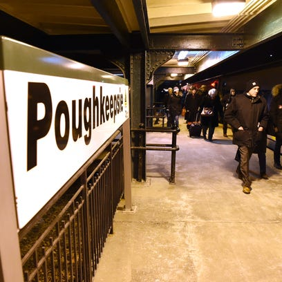 From left, Leigh Peterson, and Nicholas Dondero of Kingston wait for their train to Grand Central Terminal at the Poughkeepsie train station on Thursday.  Peterson and Dondero head to the city multiple times a year to see concerts.