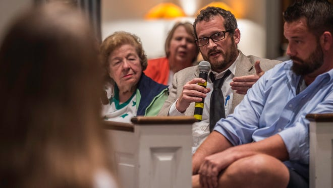 A citizen asks a question during a community forum on opioid addiction, held at First Christian Church in Richmond, Ind., on Wednesday, Oct. 18, 2017.