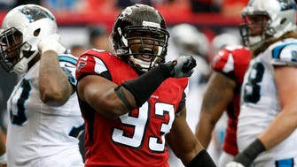 Atlanta Falcons defensive end Dwight Freeney (93) celebrates a sack of Carolina Panthers quarterback Cam Newton (1) in the second quarter of their game at the Georgia Dome.