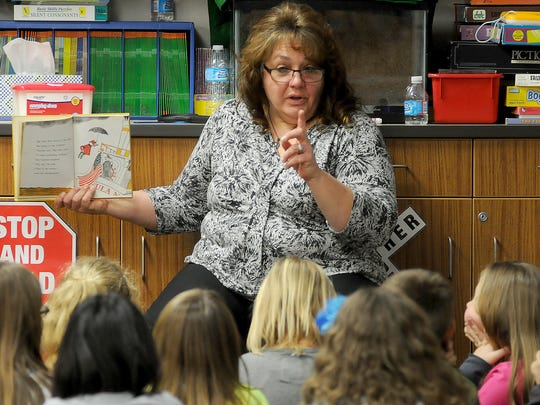 "Jenny Vermillion reads the book ""Big Max"" to Mrs. Mutchler's third-grade class on a 2015 afternoon at Bucyrus Elementary. The Lifelong Bucyrus resident is seeking to become the first woman elected mayor of the city."