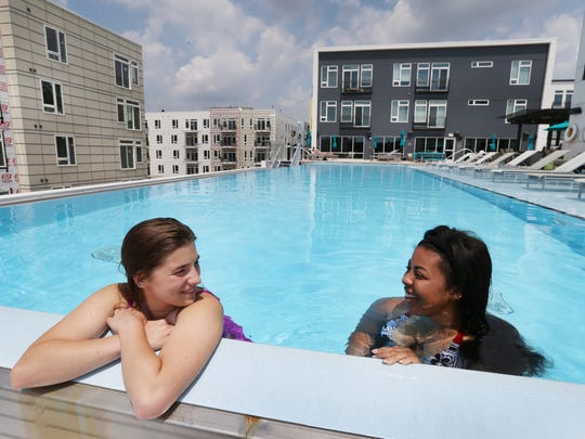 Jackie Newsome (left) and Ikia Pierre, both Indianapolis, cool down in the swimming pool atop The Artistry, 451 East Market St.