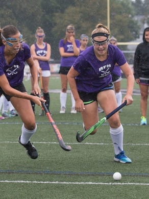 Katie MacGillis and Lily Croddick battle for ball during drills during a recent preseason practice as they prepare for their season opener.