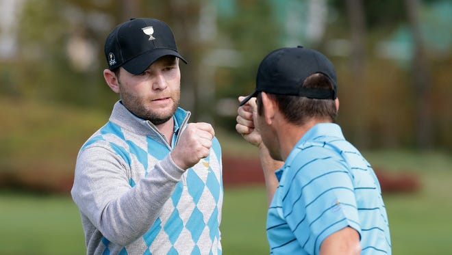 Branden Grace and Louis Oosthuizen of South Africa and the International Team celebrates on the 7th hole during the Saturday four-ball matches at The Presidents Cup at Jack Nicklaus Golf Club Korea on October 10, 2015 in Songdo IBD, Incheon City, South Korea.  (Photo by Chung Sung-Jun/Getty Images) ORG XMIT: 580241143 ORIG FILE ID: 492113590