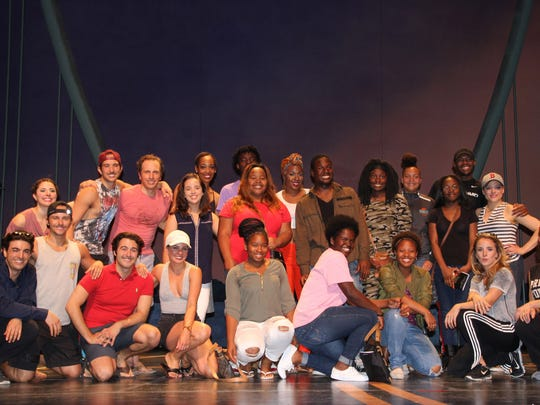 """Gifford Youth Achievement Center """"Dream Chasers"""" pose with the full cast of """"Saturday Night Fever"""" at the Riverside Theatre after the performance."""