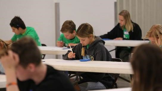 Students participate in timed math challenges during the regional 2018 MathCounts competition on Saturday at McGee Park Convention Center.