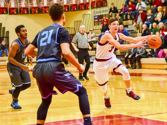 Milford senior guard Aiden Warzecha (right) drives