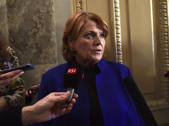 """FILE - In this Jan. 22, 2018, file photo, Sen. Heidi Heitkamp, D-N.D., talks with reporters on Capitol Hill in Washington. A pair of U.S. Senators urged Congress on June 1 to consider legislation that would rein in President Donald Trump's trade actions in light of tariffs his administration imposed on imported steel and aluminum. Speaking to farmers in North Dakota, Heitkamp said """"maybe we need to rethink"""" policies that give the president broad international trade authority. (AP Photo/Susan Walsh, File)"""