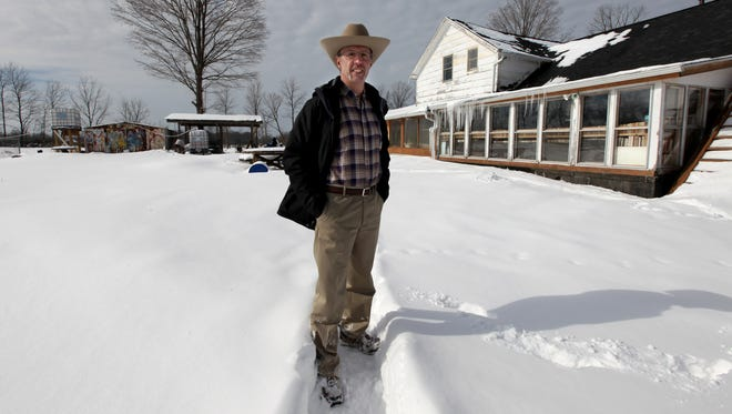 """Wladyslaw """"Wally"""" Kowalski, 60, stands on his property with his home in background in Bloomingdale Mich. on Friday, Feb. 6, 2015."""