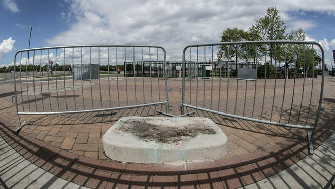 A concrete stand is all that's left where the statue of Kate Smith was displayed at Xfinity Live near the sports stadium in South Philadelphia. Sunday, April 21, 2019. The Philadelphia Flyers have removed a statue of late singer Kate Smith outside NHL team's arena.