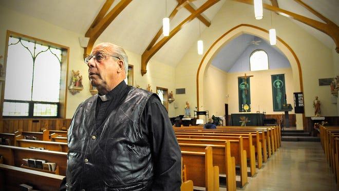 Father Julius Beckermann stands in the Jacob's Prairie church building Oct. 1.
