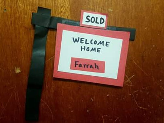 A welcome home sign is posted on Farrah Gillie's dorm