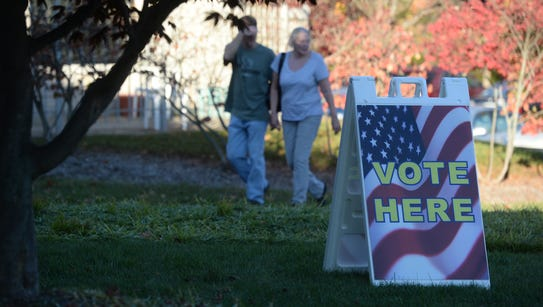 Voters arrive to vote Tuesday, Nov. 3, 2015, at First