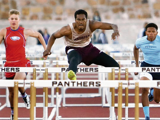 Rudy Gutierrez—El Paso Times Elden Coleman, center, of Andress clears hurdles as he steams to the finish line to capture first place in the varsity boy's 110 meter hurdles during the District 1-5A track meet Friday at Austin High School.