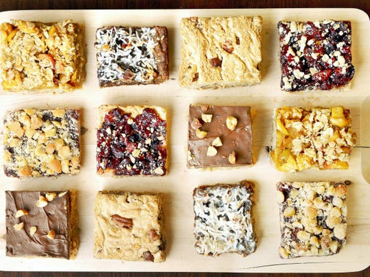 A tray of dessert bars featuring Cranberry Pear Bars, Apple Crumb Bars, Hazelnut Jam Bars, Chocolate-Coconut Bar, Chocolate-Butterscotch Crispy Bars and Jack's Favorite Blondies. (Michael Henninger/Pittsburgh Post-Gazette/TNS)