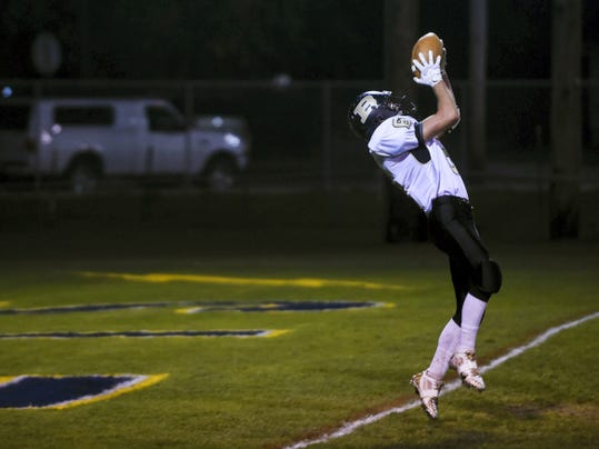 Biglerville's Scott Cooper falls back with a catch to land a touchdown in the first half of Friday night's game against Littlestown on Oct. 17, 2014.
